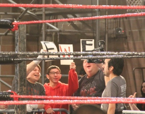 Fans holding up a self-made FWE Sign. Photo by: Stacy Podelski / 1495 Sports