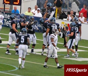 Villanova QB John Robertson and teammates celebrating. Photo by: Stacy Podelski/1495 Sports