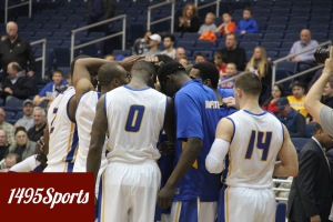 The Hofstra Men's Basketball team huddle up prior to the first game of the 2014-15 Season. Photo by: Stacy Podelski/1495 Sports