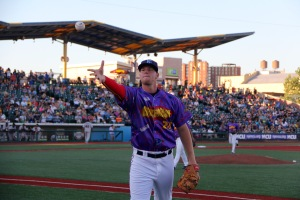Jeff Diehl seen wearing the 'Saved by the Bell Jersey' tossing a foul ball to a fan was the hero in the Cyclones Extra Inning Thriller on 6/24. Photo by: Stacy Podelski/1495 Sports