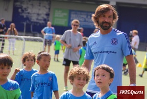 Andrea Pirlo with members of Downtown United SC. Photo by: Stacy Podelski/1495 Sports