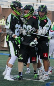 Matt Gibson is surrounded by his teammates during one of his four goals scored in the New York Lizards OT victory over the Boston Cannons. Photo by: Stacy Podelski/1495 Sports