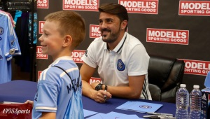 David Villa with a young fan. Photo by: Stacy Podelski/1495 Sports